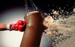 Image of a boxing glove exploding a punching bag